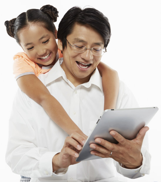 Daddy and daughter enjoy playing math game on iPad